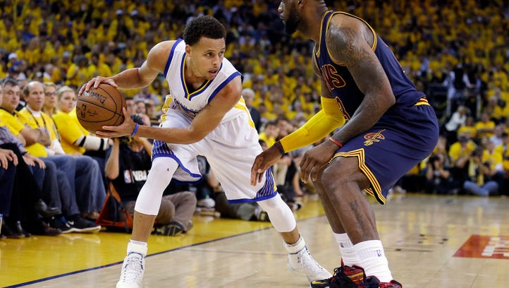 FILE - In this Jan. 18, 2016, filephoto, Golden State Warriors' Stephen Curry (30) knocks the ball loose from Cleveland Cavaliers' LeBron James (23) duriing the first half of an NBA basketball game in Cleveland. James knows there's no stopping Stephen Curry. The Cavaliers, healthier and better built for the NBA Finals than a year ago, feel their best chance to beat the Warriors is to contain the MVP and sideman Klay Thompson from splashing 3-pointers for four quarters.  (AP Photo/Tony Dejak, File)