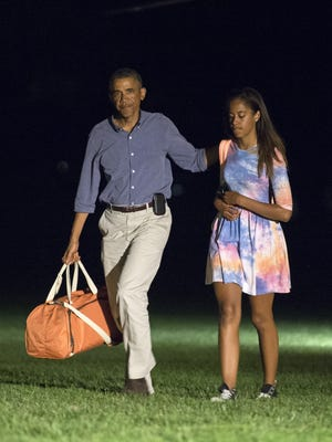 President Obama and daughter Malia return to White House on Aug. 17, after vacation in Martha's Vineyard.