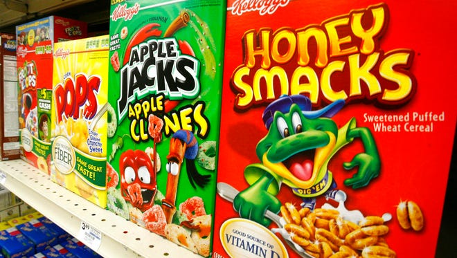 In this June 25, 2010 file photo, boxes of Kellogg's Froot Loops, Corn Pops, Apple Jacks, and Honey Smacks sit on the shelf of a Mt. Lebanon, Pa.