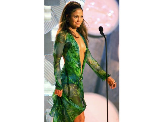 Jennifer Lopez wore a Versace jungle dress of green silk chiffon at the 42nd Grammy Awards in Los Angeles.