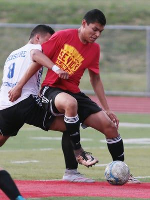 Steven Luzuriaga of Woodbridge, left, and Victor Bonilla of Piscataway in action at the 