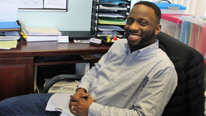 """Demudia """"Ide"""" Okojie sits at his sparsely decorated office at 125 Executive Drive. Entering his third month on the job, he is in charge of managing the daily operations of the Marion County Family and Children First Council."""