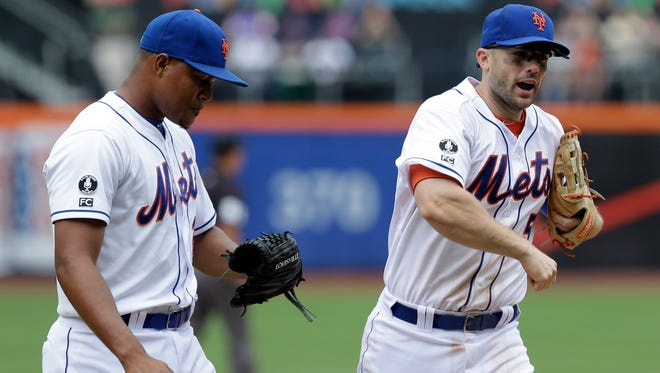 The Mets' David Wright, right, reacts as he comes off the field with relief pitcher Jeurys Familia during the eighth inning against the Marlins at Citi Field on Sunday.