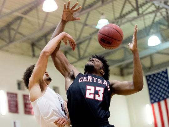 Central's Sean Oglesby (23) defends against Oak Ridge's Seth Caldwell (4) during a game between Oak Ridge and Central at Oak Ridge in Oak Ridge, Tennessee on Friday, January 5, 2018.