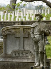 This statue of a Confederate soldier marks the graves