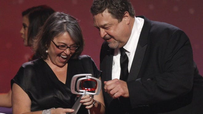Associated Press Roseanne Barr and John Goodman, of the cast of 'Roseanne,' accept the innovation award at the TV Land Awards in 2008 in Santa Monica, Calif.