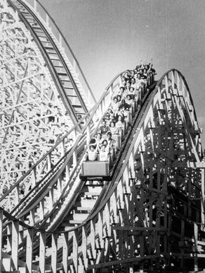 1979: The Rolling Thunder double wooden roller coaster in action.