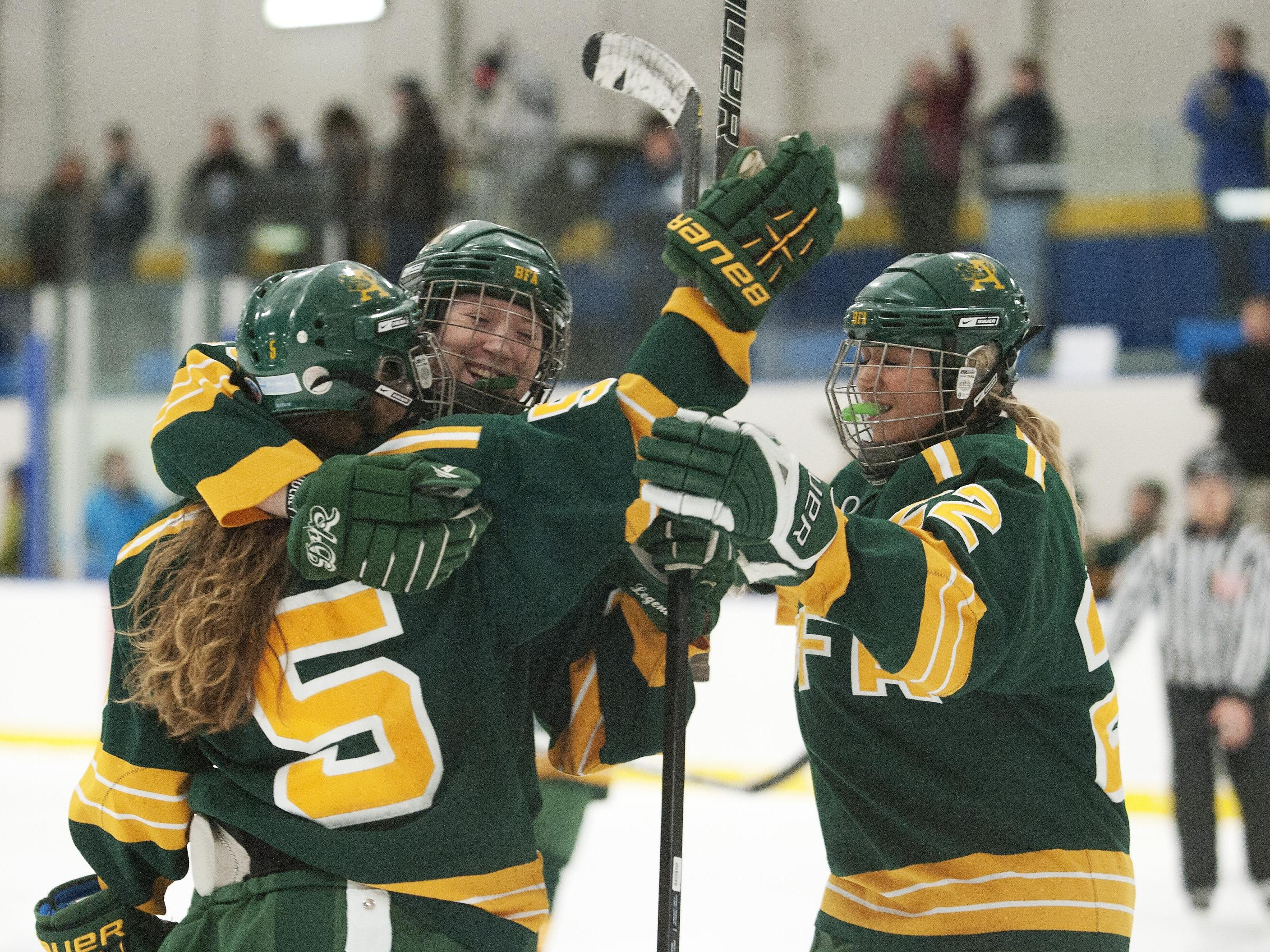 BFA celebrates a goal celebrates a goal during the girls hockey game between BFA St. Albans and Essex at Essex High School on Saturday afternoon January 26, 2013 in Essex, Vermont. (BRIAN JENKINS, for the Free Press)
