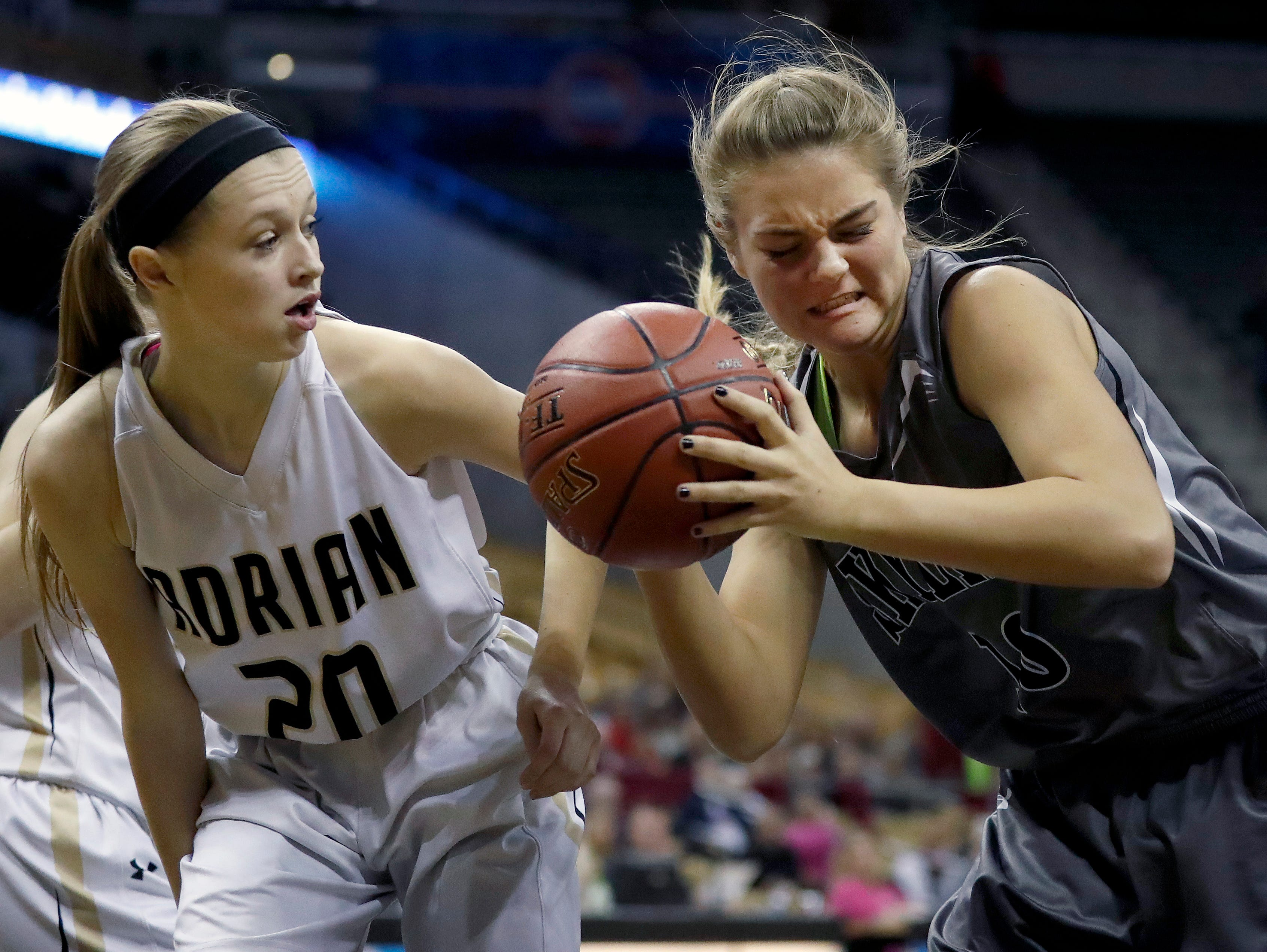 Skyline's Savannah Owen, right, holds the ball as Adrain's Kerigan Wimsatt watches during the first half of the Missouri Class 2 girls high school championship basketball game Saturday, March 11, 2017, in Columbia, Mo. (AP Photo/Jeff Roberson)