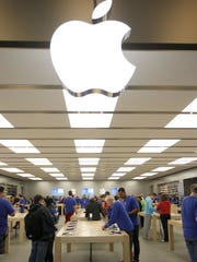 The Apple Store in Kenwood Mall on Friday morning as people purchase the new iPhone 6 and 6 Plus. Some people started to wait Thursday night outside of the mall. Friday was the first day the iPhone 6 and 6 Plus were available to purchase.