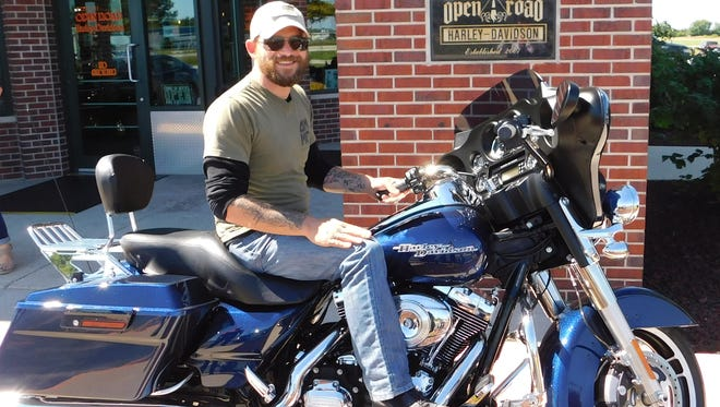 On Sept. 2, the Hogs for Heroes board took Daniel Tinsley shopping for his first Harley at Open Road Harley-Davidson in Fond du Lac, and he chose a fully loaded pre-owned 2012 Street Glide.
