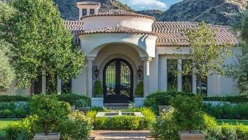Aniket and Amruta Vadnerkar purchased this 7,018-square-foot Santa Barbara/Tuscan-style estate in Paradise Valley's Mockingbird Lane Estates.