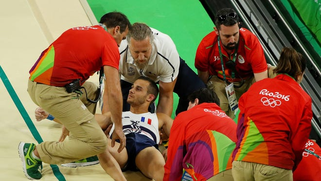 Samir Ait Said of France receives medical attention after breaking his leg during a vault exercise at the 2016 Rio De Janeiro Olympic games. The gruesome injury caused spectators to let out an audible gasp.