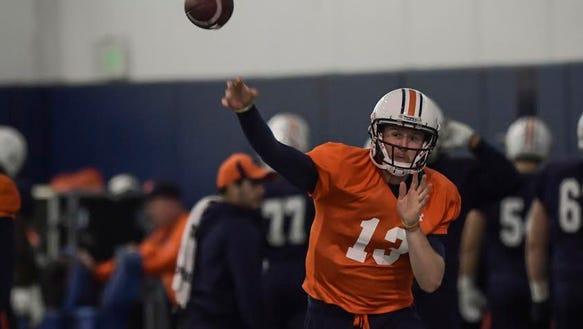 Auburn quarterback Sean White throws a pass in practice