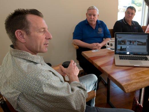 AeroFest organizer Dave Glassman, left, makes plans