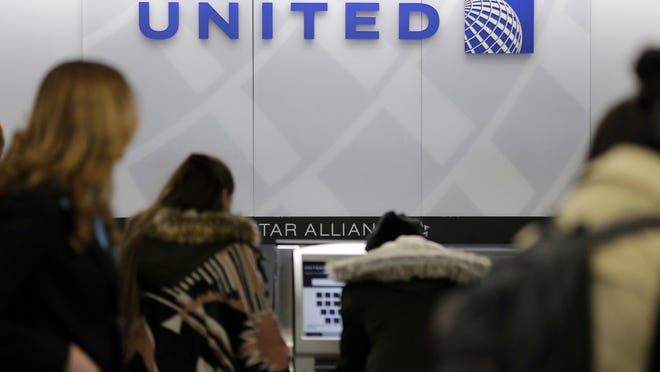 Last year, 18 animals, mostly dogs, died while being transported on United Airlines – three-fourths of all animal deaths on U.S. carriers. Seth Wenig/AP FILE- In this March 15, 2017, photo, people stand in line at a United Airlines counter at LaGuardia Airport in New York. A dog died on a United Airlines plane after a flight attendant ordered its owner to put the animal in the plane's overhead bin. United said Tuesday, March 13, 2018, that it took full responsibility for the incident on the Monday night flight from Houston to New York. (AP Photo/Seth Wenig, File)