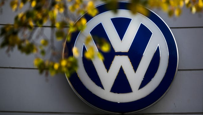 The VW sign of Germany's Volkswagen car company is displayed at the building of a company's retailer in Berlin.