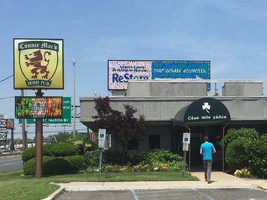 Patron enters Connie Mac's Irish Pub in Pennsauken, planned site of a Wawa