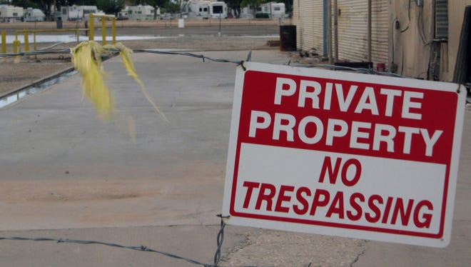 In this Oct. 29, 2009 photo, a defunct brine well operation once owned by I&W Trucking in Carlsbad, N.M., is fenced off because state officials fear a cavern that has formed under the site as a result of nearly 30 years of brine production is at risk of collapsing. A state official says New Mexico is only a few steps away from being able to backfill a giant underground cavern before it collapses underneath a community of mobile homes and critical transportation routes in southern New Mexico.