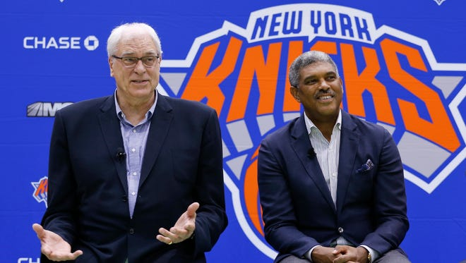 Knicks president Phil Jackson, left, and general manager Steve Mills answer questions during a news conference at the team's training facility, Friday, July 8.