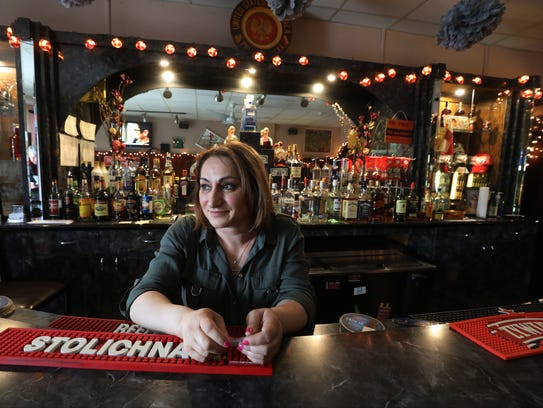Jolanta Szyszko, a Polish immigrant, works the bar