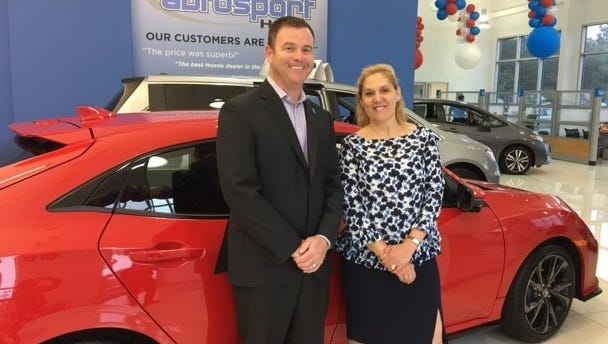 Steve Lustig, vice president Autosport Honda with Bunny Flanders, director of Marketing and Communications.