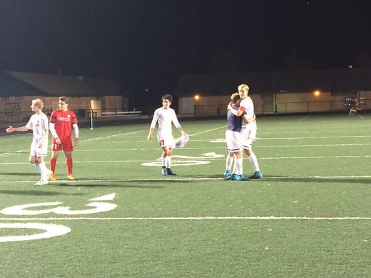 Mason soccer celebrate semifinal win