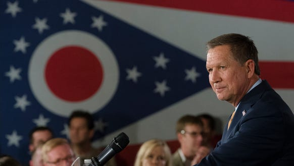 John Kasich speaks during a watch party at the Renaissance