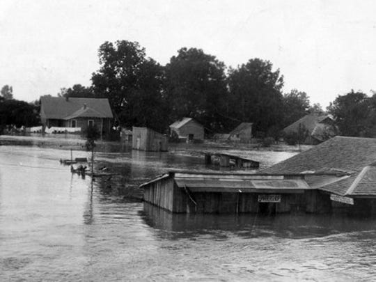 The town of Melville, Louisiana, was flooded in May of 1927 when a levee broke along the Atchafalaya River.