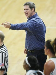 FGCU coach Karl Smesko argues a call against Arkansas State on Saturday (11/28/15) at Alico Arena in Fort Myers. Arkansas beat FGCU 62-48.
