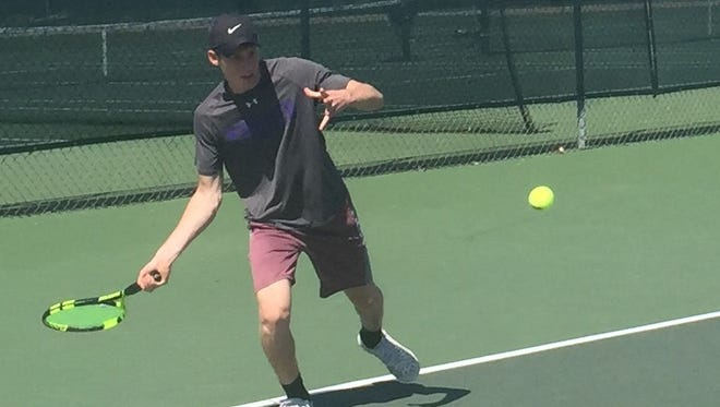 Cypress Lake senior Zachary Blythe attempts to return a ball on Tuesday during the Panthers' Region 2A-6 match against Lemon Bay. The Panthers won 5-0.