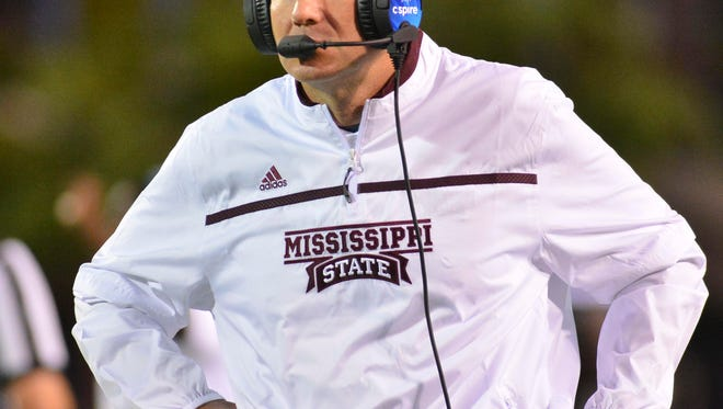 Mississippi State Bulldogs coach Dan Mullen talks into a headset during the 2nd quarter of the game against the LSU Tigers at Davis Wade Stadium. Mandatory Credit: Matt Bush-USA TODAY Sports