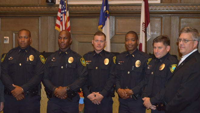 Here are the five new officers sworn in Wednesday night for the Asheville Police Department. From left to right, Officer Peter Balthrop, Officer Nathaniel Smith, Officer Daniel Johnson, Officer Juan Gonzalez, Officer Keith Sanders and Deputy Chief Wade Wood.