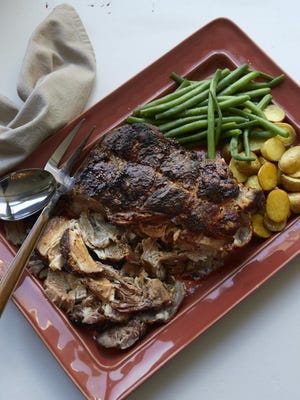 Fall-apart roasted pork shoulder with rosemary, mustard and garlic makes good use of a big, tough hunk of meat that needs low and slow cooking to make it turn from impossibly tough to tender.