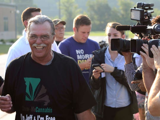 Jeff Mizanskey smiles as he walks away from cameras after being released from the Jefferson City Correctional Center, after serving two decades of a life sentence for a marijuana-related charge in Jefferson City, Mo., on Tuesday, Sept. 1, 2015.  His release followed years of lobbying by relatives, lawmakers and others who argued that the sentence was too stiff and that marijuana should not be forbidden.   (AP Photo/Columbia Missourian/Justin L. Stewart)