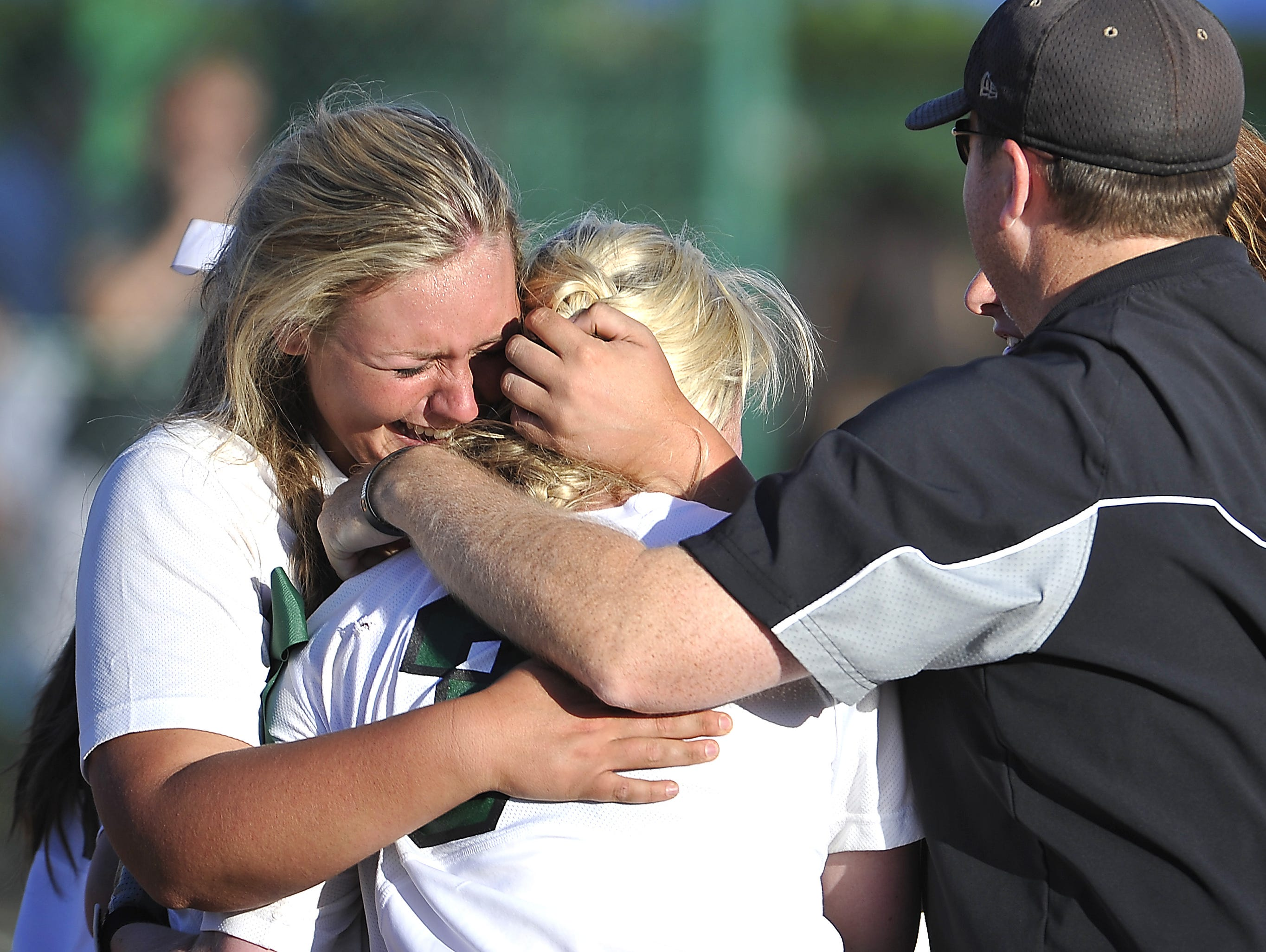 Courtney Miles and Jordan Burton embrace after winning the 2015 Division II-A championship.