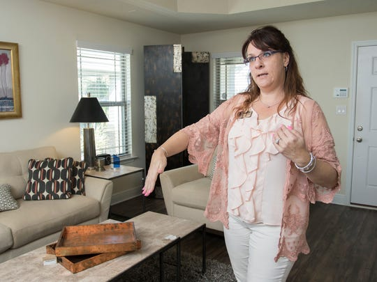 Adams Homes sales manager Andrea De La Cerna gives