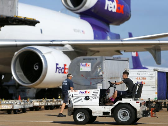 A tug operator drives across the ramp at the FedEx Hub at Memphis International Airport on October 18, 2016.