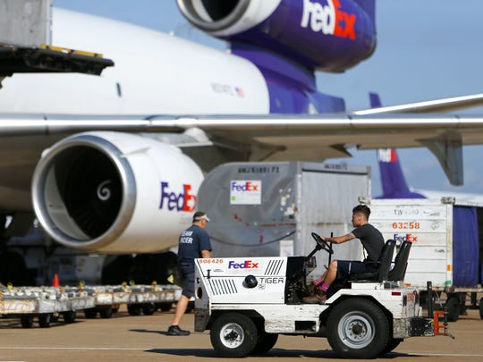 A tug operator drives across the ramp at the FedEx Hub at Memphis International Airport. FedEx was No. 99 on a list of the nation?s top companies to work for. October 18, 2016 - A tug operator drives across the ramp at the FedEx Hub at Memphis International Airport on Oct. 18, 2016.