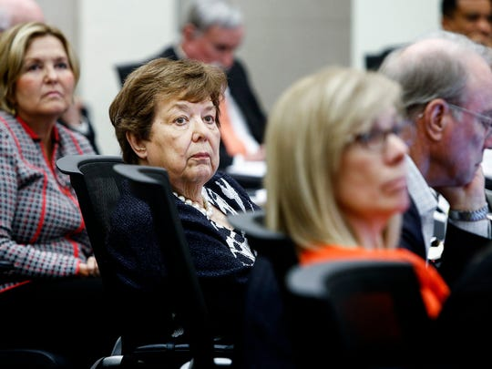 Julia T. Wells, middle, listens to speakers during the University of Tennessee board of trustees quarterly meeting at the UT Health Science Center campus in Memphis.