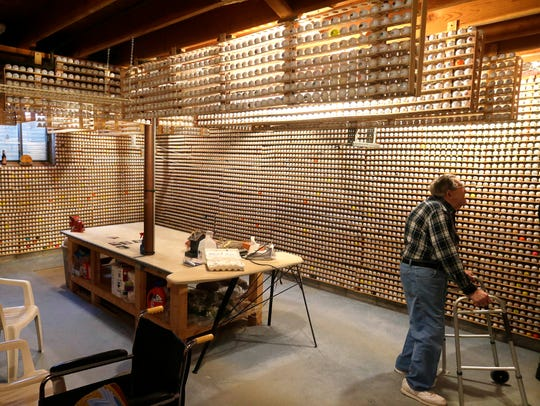 Don Thompson's collection of logo golf balls runs from floor to ceiling with additional racks between the joists of his basement. The collection numbers more than 15,000, each with a different logo.