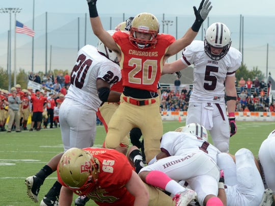 From 2012 at Overpeck Park: Bergen Catholic's James Dawson puts up his hands as Jon Germano finds the endz one at the bottom of the pile Saturday against Don Bosco at Overpeck Park
