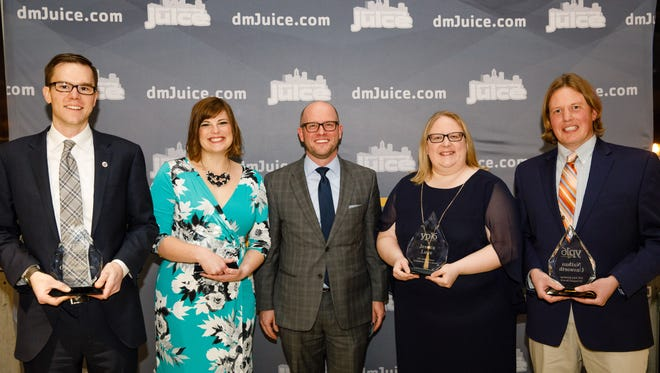 Award winners (from left) Kyle Oppenhuizen, Allison Fegley, Des Moines Register Publisher David Chivers, Jessica Lowe, and Nathan Unsworth Thursday, Feb. 9, 2017, during the 2016 Young Professional of the Year Awards at Sticks, Inc. in Des Moines.
