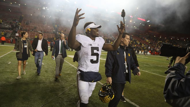 00023539A --  Piscataway, New Jersey  --  October 8,   2016  --- Michigan vs Rutgers -- Big Ten Football --  Jabrill Peppers of Michigan acknowledges the accolades of fans as he leaves the field at the end of the game.   --  CHRIS PEDOTA / THE RECORD