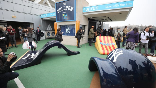 This is part of the Sunrun Kids Clubhouse with slides a tunnels in an area for kids to play during the game.