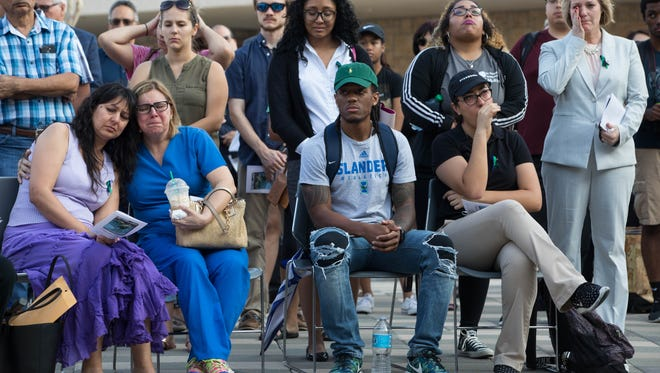 Faculty, students, friends and family members of Texas A&M University-Corpus Christi students who died this past year gather at the Islander Tribute memorial during a ceremony Tuesday, April 4, 2017.