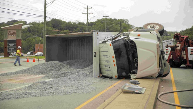 A truck overturned on Second Street near Riverside Drive Wednesday afternoon, spilling its load of gravel.
