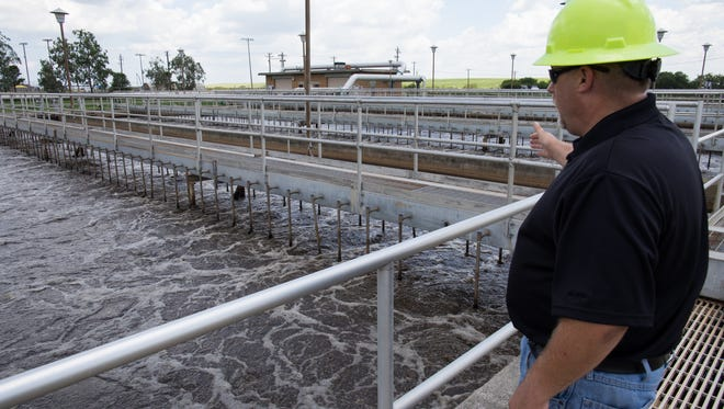Work coordinator Harry Clifford explains how Greenwood Wastewater Treatment Plant's aeration basin works during a tour on Tuesday, June 6, 2017. The Greenwood plant is a flash point in the debate over how to modernize the city of Corpus Christi aging wastewater treatment system.