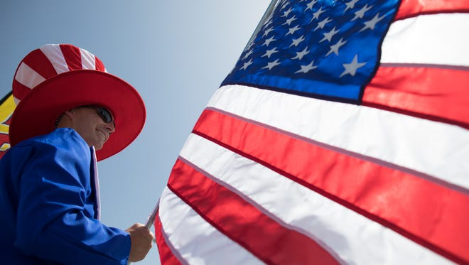 A man on stilts dressed as Uncle Sam waves the American flag. Pensacola non-profit Real Women Radio and the Vote Together initiative are partnering to host community events aimed at making Election Day a time of togetherness, celebration and community excitement.