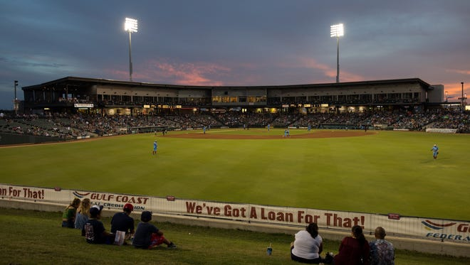 Fans sits on the outfield berm during the Hooks game against Northwest Arkansas Naturals at Whataburger Field on Friday, July 7, 2017.